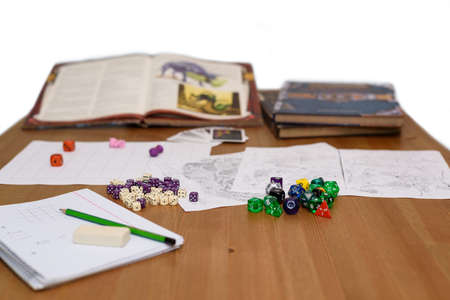 role playing game set up on table isolated on white Stock Photo