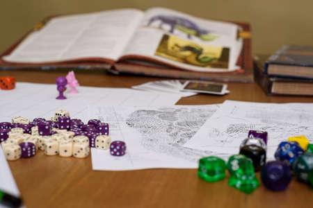 set up: role playing game set up on table on beige  Stock Photo