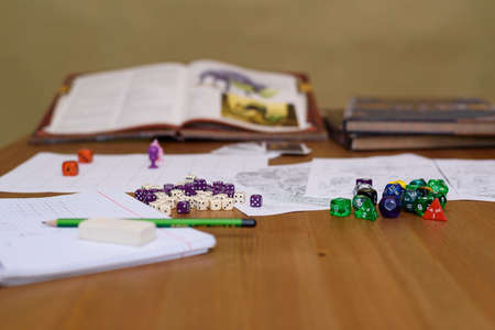 role playing: role playing game set up on table on beige  Stock Photo