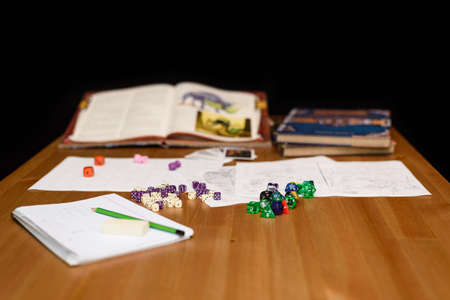 role playing: role playing game set up on table isolated on black