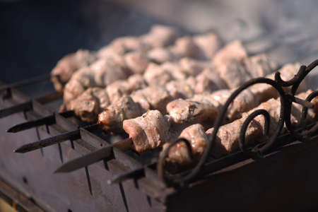 The kebabs are cooked outdoors