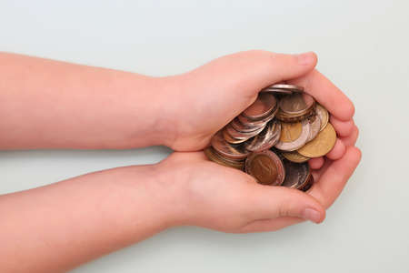 Banknotes and coins on the table and in the hands