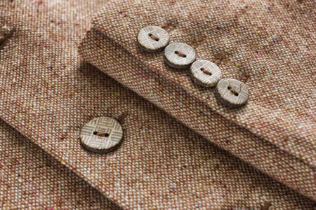 Tweed jacket with its details of buttons