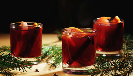 Hot wine drink. Warm Christmas wine. Mulled wine with oranges Stock Photo