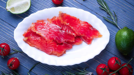 Fish sliced on the table for meals. Delicious seafood dinner. Tr Stock Photo