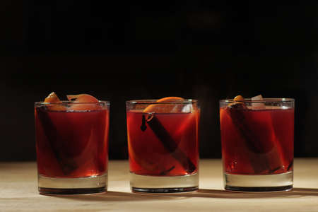 Hot wine drink. Warm Christmas wine. Mulled wine with oranges an Stock Photo