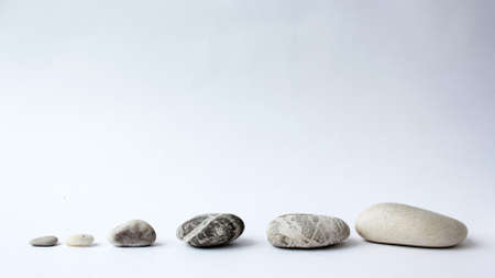 Balance of stones. Stones for spa treatments on a white backgrou