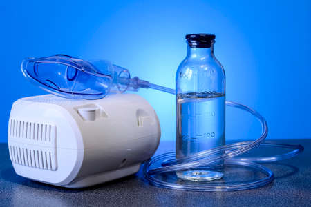 Medical nebulizer for the treatment of bronchitis. Camera agains Stock Photo