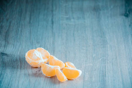 A composition of fresh mandarins on the table in the afternoon.