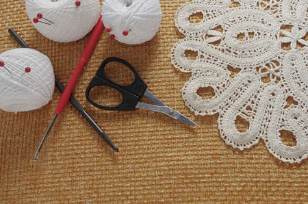 Objects for sewing. Scissors and pins. Hanks thread on mat. Pins Stock Photo