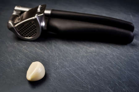 A composition of cloves of garlic on the table. Healthy eating.