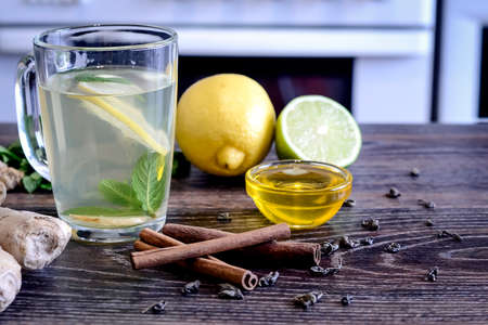 Drink from the lemon on the table. Lemon and ginger drink. The w Stock Photo