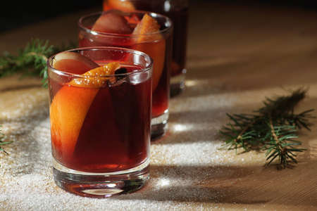 Hot wine drink. Warm Christmas wine. Mulled wine with oranges an Stok Fotoğraf