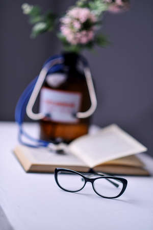 Stethoscope and book on Desk Stock Photo