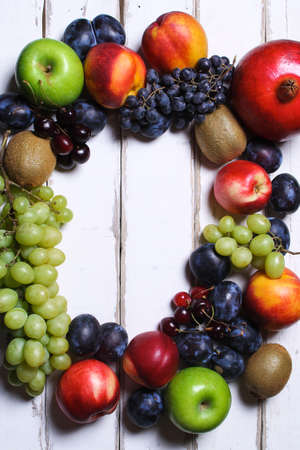 Prunes and grapes on the table poster