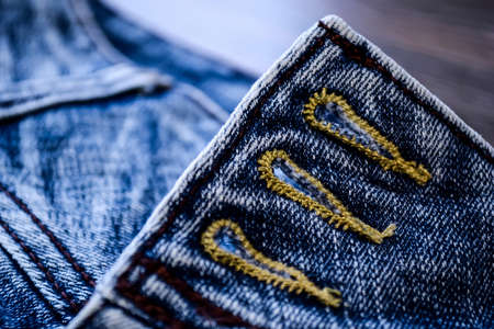 Denim clothes lying on the table with the glasses. Blue jeans wi