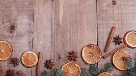 Dry slices of oranges lying on the table. Decorative ornament.