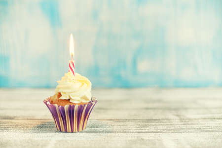 Festive cupcakes with burning candles Imagens