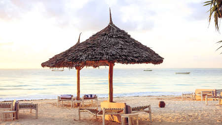 Beach with sun loungers and a place for rest at sunset. A beauti Stock Photo
