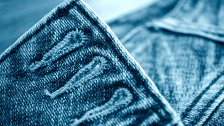 Denim clothes lying on the table with the glasses. Standard-Bild