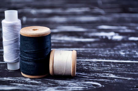 The spool of thread on the table. Thread on a reel for craft. Ma