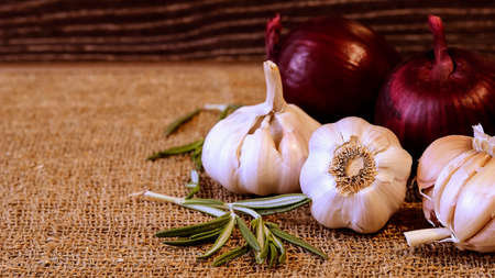Garlic and cloves lying on a napkin. Healthy food and spices. Ad