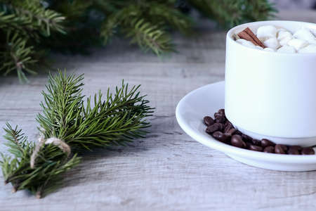 Coffee with marshmallows at the Christmas tree. Festive warming Standard-Bild