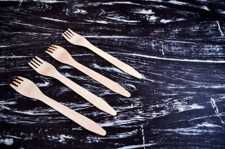 Silver fork lying on a wooden table. Cutlery for eating. Device