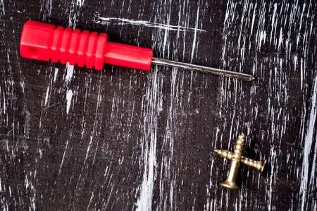 Screwdrivers to repair lying on the table. Mens housework. Fix Standard-Bild