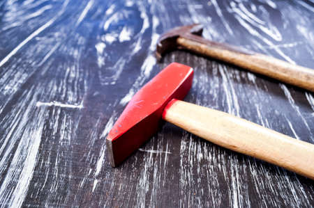 Hammer to repair lying on a wooden table. Mens housework. Worki