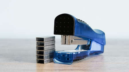 Stapler for office work on the table. Stationery item. Office su Standard-Bild
