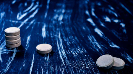 Pills and vitamins for health on the table. Medications to treat Imagens