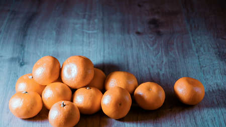 A composition of fresh mandarins on the table in afternoon. Imagens