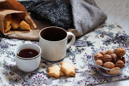 Coffee and delicious pastries for breakfast in the morning. Nuts