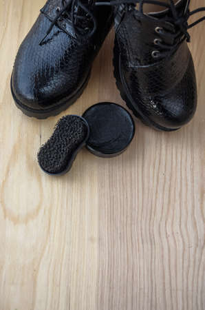 Shoes and scouring cream on the floor. Clean shoes for walking.