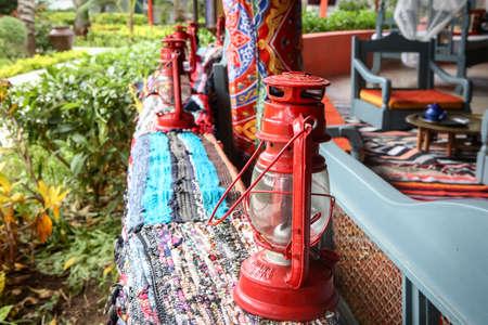 Street lanterns in the gazebo on the street. Oil lamps for decor
