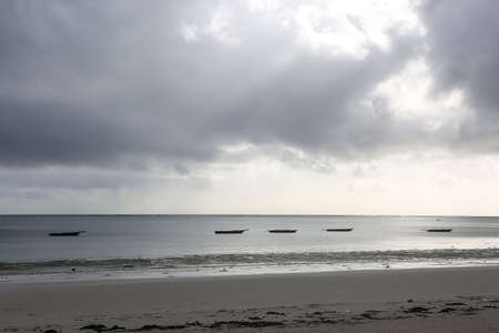 Boats in the ocean bay on a sunny afternoon. Fishing boats in th Imagens