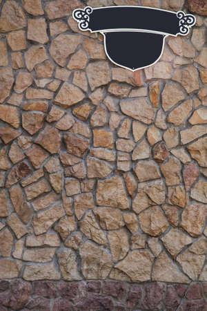 adress: Stone wall and adress signboard