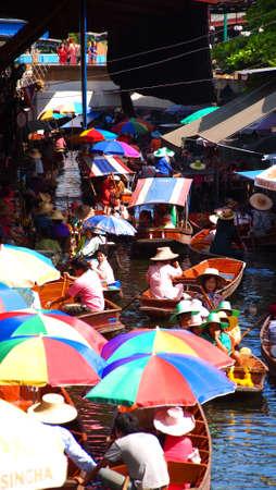 damneonsaduak: RATCHABURI,THAILAND-SEPTEMBER 30:Unidentified People and Tourist on the boat tour Damneonsaduak Floating Market on September 30,2012 in Ratchaburi,Thailand