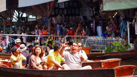 RATCHABURI,THAILAND-SEPTEMBER 30 : Unidentified People and Tourist on the boat tour Damneonsaduak Floating Market on September 30,2012 in Ratchaburi,Thailand. Stock Photo - 15485106