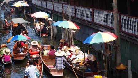 RATCHABURI,THAILAND-SEPTEMBER 30 : Unidentified People and Tourist on the boat tour Damneonsaduak Floating Market on September 30,2012 in Ratchaburi,Thailand.
