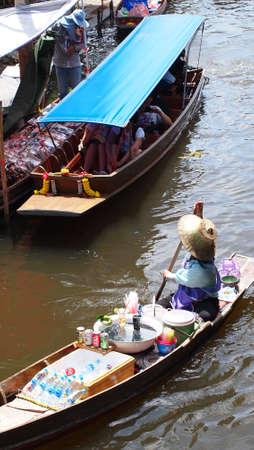 damneonsaduak: RATCHABURI,THAILAND-SEPTEMBER 30 : Unidentified People and Tourist on the boat tour Damneonsaduak Floating Market on September 30,2012 in Ratchaburi,Thailand.
