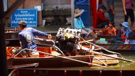 RATCHABURI,THAILAND-SEPTEMBER 30 : Unidentified People and Tourist on the boat tour Damneonsaduak Floating Market on September 30,2012 in Ratchaburi,Thailand. Stock Photo - 15485109