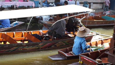 RATCHABURI,THAILAND-SEPTEMBER 30 : Unidentified People and Tourist on the boat tour Damneonsaduak Floating Market on September 30,2012 in Ratchaburi,Thailand.
