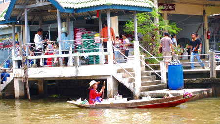 RATCHABURI,THAILAND-SEPTEMBER 2 : Unidentified People and Tourist on the boat tour Damneonsaduak Floating Market on September 2,2012 in Ratchaburi,Thailand.