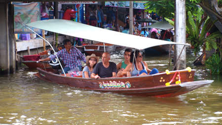 RATCHABURI,THAILAND-SEPTEMBER 5 : Unidentified People and Tourist on the boat tour Damneonsaduak Floating Market on September 5,2012 in Ratchaburi,Thailand.