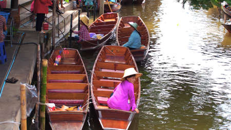 RATCHABURI,THAILAND-SEPTEMBER 10 : Unidentified People and Tourist on the boat tour Damneonsaduak Floating Market on September 10,2012 in Ratchaburi,Thailand.