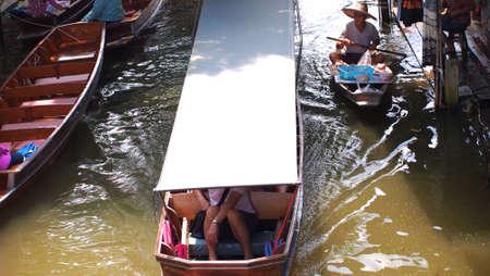 RATCHABURI,THAILAND-SEPTEMBER 12 : Unidentified People and Tourist on the boat tour Damneonsaduak Floating Market on September 12,2012 in Ratchaburi,Thailand. Editorial