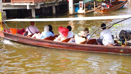 damneonsaduak: RATCHABURI,THAILAND-SEPTEMBER 14 : Unidentified People and Tourist on the boat tour Damneonsaduak Floating Market on September 14,2012 in Ratchaburi,Thailand. Editorial