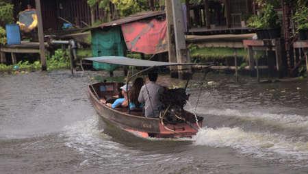 RATCHABURI,THAILAND-SEPTEMBER 16 : Unidentified People and Tourist on the boat tour Damneonsaduak Floating Market on September 16,2012 in Ratchaburi,Thailand.
